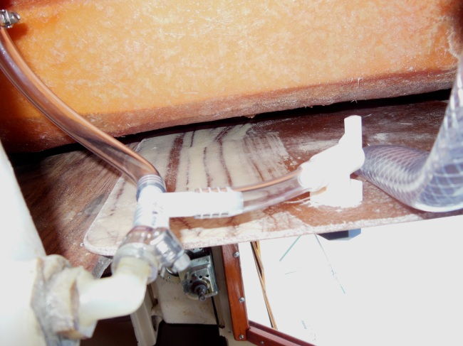 AFTER - open valve to drain tank into funnel