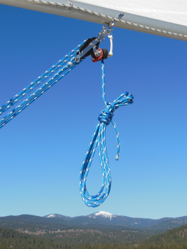 Upper fiddle block attached to the boom tang