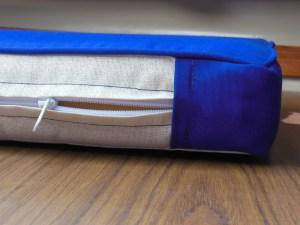 Closeup of corner and zipper plaque construction