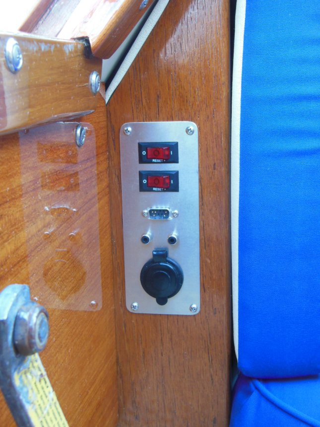 Custom accessory panel easily accessible next to the companionway