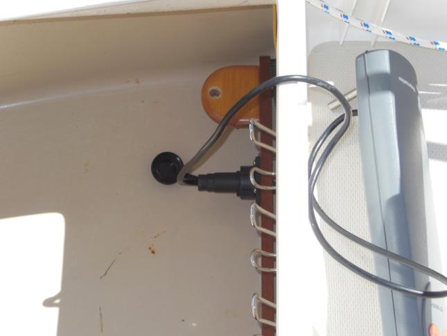 Electrical socket mounted inside the starboard lazarette