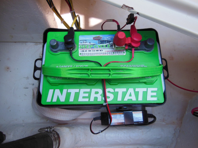 Battery with MRBF fuse block, fused outboard generator connection, and onboard charger. Battery box cover removed for this photo.