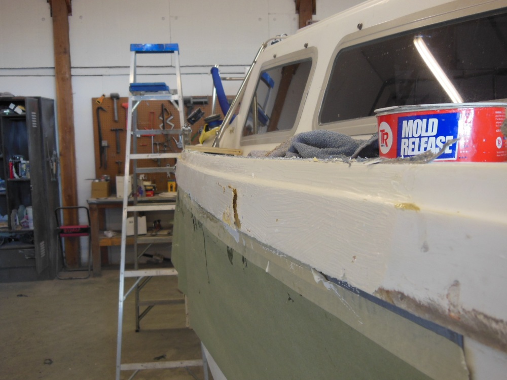 Damaged area temporarily faired with filler and topped with rough gelcoat