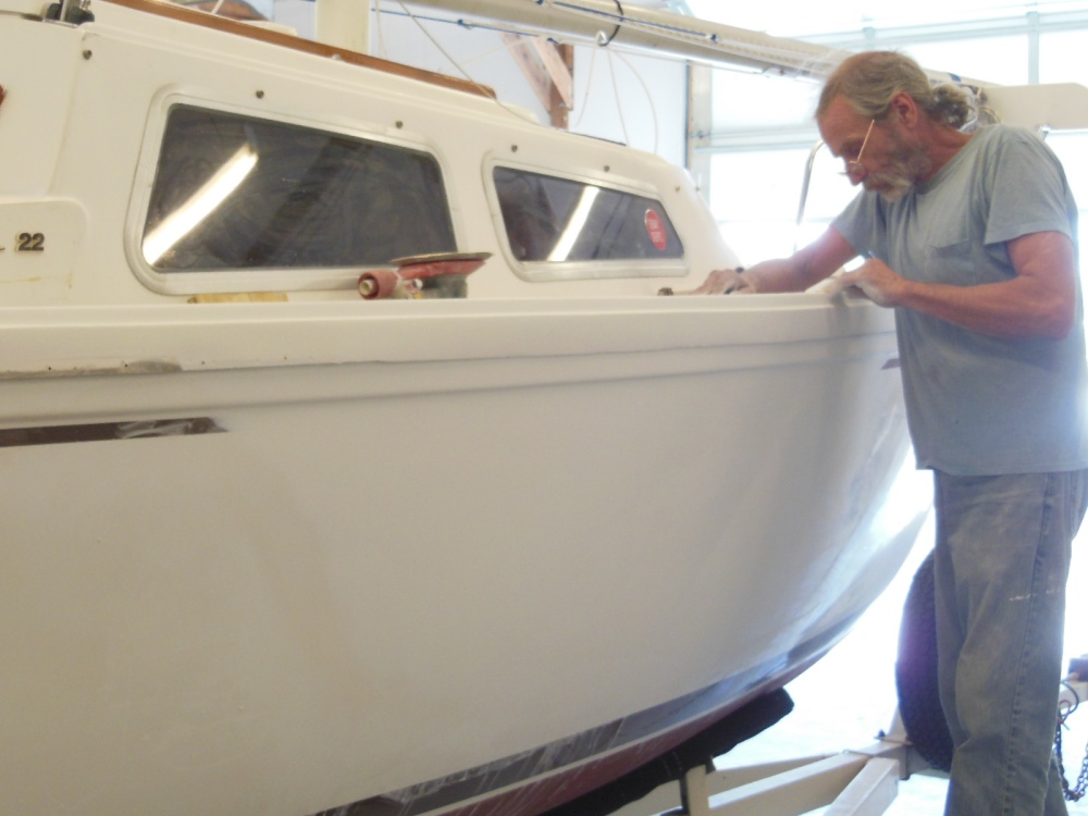 Sanding the new gelcoat smooth and blending