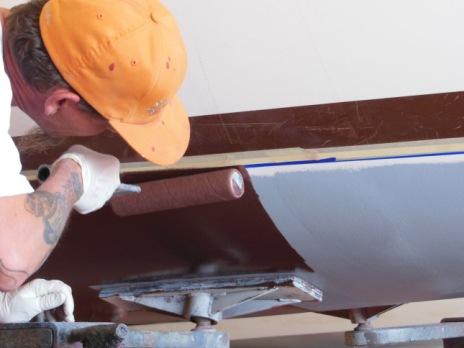 Applying bottom paint over the barrier coat