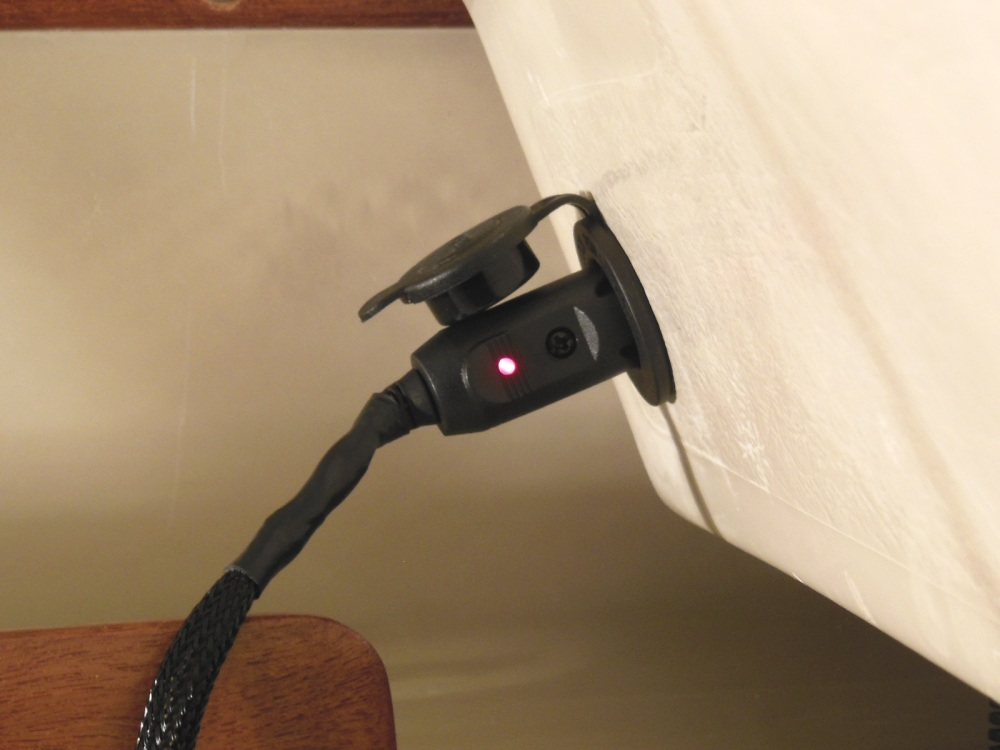 12 V accessory outlet mounted in lower starboard bulkhead can power the galley or other accessories