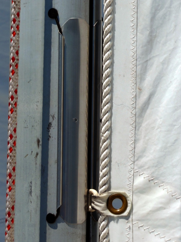 Close-up of external hinged mast gates attached by shock cord